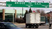Vehicles cross the Ambassador Bridge between Windsor, Ont., and Detroit on March 21, 2013. (Deborah Baic/The Globe and Mail)