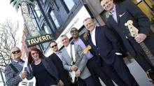 Men in Suits band members, left to right, Don Tapscott, Trish Fonberg, Vince Mazza, Gerry Throop, Duke McKenzie, Jim Hardy and Stewart Borden are photographed outside Toronto's El Mocambo. (KEVIN VAN PAASSEN FOR THE GLOBE AND MAIL)