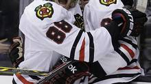 Chicago Blackhawks right wing Patrick Kane celebrates with center Andrew Shaw (Chris Carlson/AP Photo)