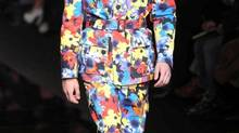 A model wears a creation of Versace men's Fall-Winter 2012-13 collection, part of the Milan Fashion Week, unveiled in Milan, Italy, Monday, Jan. 16, 2012. (Antonio Calanni)