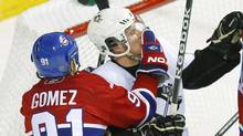 Montreal Canadiens Scott Gomez (91) grabs Pittsburgh Penguins Sidney Crosby by the face during the second period in Game 3 of their NHL Eastern Conference semi-final hockey series in Montreal, May 4, 2010. (SHAUN BEST/REUTERS)