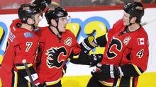 Calgary Flames' TJ Brodie and Jay Bouwmeester congratulate teammate Mike Cammalleri on his goal (STRINGER/CANADA/REUTERS)
