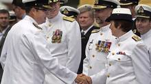 Vice Admiral Mark Norman, left, greets officers at a change of command ceremony in Halifax on July 12, 2013.