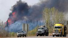 A wildfire burns near Highway 63 south of Fort McMurray, Alta., May 8, 2016. (CHRIS WATTIE/REUTERS)