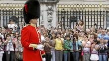 Tourists take pictures of the Changing of the Guard Ceremony at Buckingham Palace, in central London. (Stefan Wermuth/Reuters)