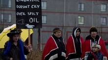A group of protesters gathers outside the Northern Gateway hearings in Prince Rupert Monday. (Jonathan Hayward/THE CANADIAN PRESS)