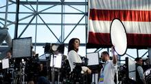 A television reporter waits to do a live shot as preparations are made for Democratic U.S. presidential nominee Hillary Clinton's election night rally at the Jacob K. Javits Convention Center in New York, Nov. 8, 2016. (MARK KAUZLARICH/REUTERS)