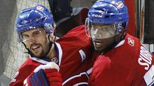 Montreal Canadiens' Brian Gionta, left, celebrates his goal with teammate P.K. Subban against the Philadelphia Flyers during third period of Game 3 NHL Eastern Conference final hockey action, May 20, 2010 in Montreal. (Ryan Remiorz/THE CANADIAN PRESS)