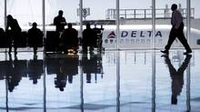 In this Thursday, Oct. 13, 2016, file photo, a Delta Air Lines jet sits at a gate at Hartsfield-Jackson Atlanta International Airport, in Atlanta. Delta is giving airport employees permission to offer passengers up to almost $10,000 in compensation to give up their seats on overbooked flights. (David Goldman/AP)
