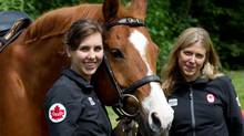 Donna Vakalis pose with a horse after being nominated to the 2012 Canadian Olympic Team in the sport of Modern Pentathlon at an event in Vancouver June 6, 2012. Equestrian is one of five sport disciplines in Modern Pentathlon. (Darryl Dyck/COC photo)