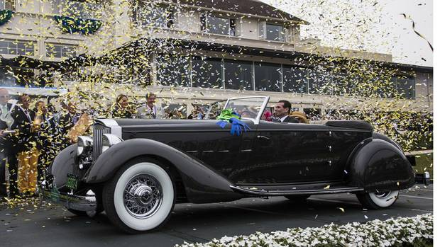 "The 1934 Packard 1108 Twelve Dietrich Convertible Victoria, owned by Joseph & Margie Cassini III, from West Orange, New Jersey, took the ""Best of Show Award"" at the Pebble Beach Concours d'Elegance in Pebble Beach, Calif., on Sunday, Aug. 18, 2013. (Tom O'Neal/AP Photo/Rolex)"