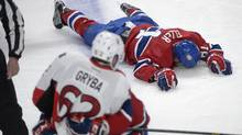 Montreal Canadiens' Lars Eller lies injured on the ice following a hit by Ottawa Senators' Eric Gryba (62) during NHL playoff action in Montreal, Thursday, May 2, 2013. (The Canadian Press)