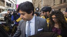 Former CBC host Jian Ghomeshi leaves court with his sister Jila, right, after signing a peace bond in Toronto on May 11, 2016. (Mark Blinch/THE CANADIAN PRESS)