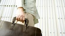 Woman carrying briefcase thinkstock (Jupiterimages/ThinkStock)