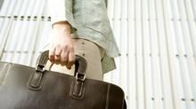 Woman carrying briefcase thinkstock (Jupiterimages/ThinkStock)