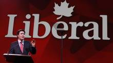 Liberal Leader Justin Trudeau gestures during his keynote address at the Liberal biennial convention in Montreal on Feb. 22, 2014.