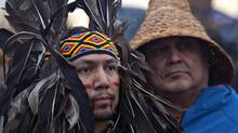First nations' protesters listen to speeches during an Idle No More march at the Peace Arch border crossing between Canada and the U.S. in Surrey, B.C., on Jan. 5 2013. (ANDY CLARK/REUTERS)