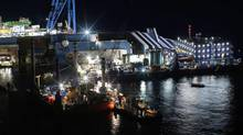 The Costa Concordia will likely remain in Giglio harbour until this fall. There are 450 workers on site in what has become the biggest salvage effort ever undertaken, CBS News reported. (TONY GENTILE/REUTERS)
