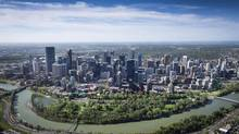 Calgary, with the Bow River, are seen on June 4, almost a year after the city was badly flooded. (John Lehmann/The Globe and Mail)