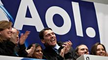 Tim Armstrong, chairman and chief executive officer of AOL Inc., centre, laughs during the opening bell ceremony at the New York Stock Exchange in New York, U.S., on Thursday, Dec. 10, 2009. (Daniel Acker)