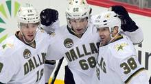 From left, Dallas Stars' Reilly Smith, Jaromir Jagr (68), of the Czech Republic, and Vernon Fiddler (38) celebrate Jagr 's goal against the Colorado Avalanche during the first period of an NHL hockey game on Wednesday, March 20, 2013, in Denver. (Barry Gutierrez/THE CANADIAN PRESS)