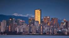 The sunset is reflected in Vancouver skyscrapers on Jan. 20, 2010. (JOHN LEHMANN/JOHN LEHMAN/GLOBE AND MAIL)