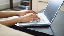 Hands typing on laptop (Jupiterimages/Getty Images)