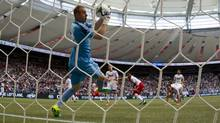Vancouver Whitecaps' goalkeeper Brad Knighton makes a save against the Portland Timbers during the first half of an MLS game in Vancouver, B.C., on Saturday, May 18, 2013. (DARRYL DYCK/THE CANADIAN PRESS)