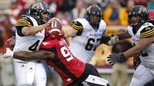 Hamilton Tiger-Cats' quarterback Zach Collaros, left, takes a hard hit from Calgary Stampeders defensive lineman Micah Johnson but would still get the ball away during second half CFL football action in Calgary, Alberta on Sunday, Aug. 28, 2016. (Larry MacDougal/THE CANADIAN PRESS)