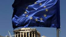 A European Union flag waves above the ancient Parthenon temple, at the Acropolis Hill, in Athens on Monday, July 11, 2011. (Petros Giannakouris/AP)