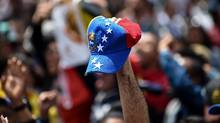 Venezuelans residing in Colombia gather at Bolivar square in Bogota to take part in a symbolic plebiscite called by the Venezuelan opposition on President Nicolas Maduro's project of a future constituent assembly, on July 16, 2017. (RAUL ARBOLEDA/AFP/Getty Images)