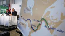 TransCanada President and CEO Russ Girling, right, announces the new Energy East Pipeline during a news conference in Calgary in this Aug. 1, 2013, file photo. (TODD KOROL/REUTERS)