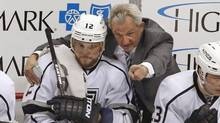 Los Angeles Kings' Marian Gaborik gets instruction from head coach Darryl Sutter in the first period of an NHL hockey game against the Pittsburgh Penguins in Pittsburgh, on March 27, 2014. (Gene J. Puskar/The Associated Press)
