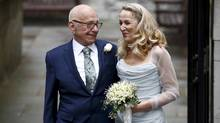 Media mogul Rupert Murdoch and former supermodel Jerry Hall pose for a photograph outside St Bride's church following a service to celebrate their wedding which took place on Friday, in London, Britain March 5, 2016. (Peter Nicholls/REUTERS)