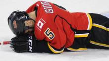 Calgary Flames' Mark Giordano lays on the ice injured during the first period of their NHL hockey game against the Nashville Predators in Calgary, Alberta, November 29, 2011. REUTERS/Todd Korol (Todd Korol/Reuters)
