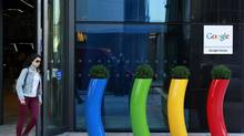 A woman walks past the Google offices near the city centre in Dublin. Many international companies have offices in Ireland because of its low tax rates. (CATHAL MCNAUGHTON/REUTERS)