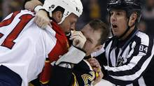 Brawls, like this one between Panthers' Krys Barch and Bruins' Shawn Thornton, are incresingly rare – more than 70 per cent of games went fightless last season. (Elise Amendola/The Associated Press)