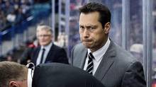 In this Oct. 4, 2016, file photo, Ottawa Senators head coach Guy Boucher looks on as his team takes on the Toronto Maple Leafs during the first period of an NHL preseason hockey game in Saskatoon. (Liam Richards/THE CANADIAN PRESS)