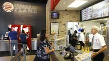 A customer orders food at a Burger King restaurant in Miami. (Luis M. Alvarez/Luis M. Alvarez/AP)