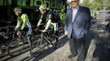 Dorel Industries CEO Martin Schwartz, right, looks on as professional cyclist Peter Sagan, centre, and members of his team saddle up in Montreal, Monday, September 16, 2013. photo Graham Hughes for The Globe and Mail. (Graham Hughes For The Globe and Mail)