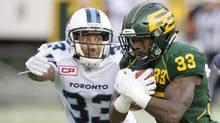 Toronto Argonauts Aaron Berry (33) gives chase on Edmonton Eskimos Shakir Bell (33) during second half CFL action in Edmonton, Alta., on Saturday November 5, 2016. (JASON FRANSON/THE CANADIAN PRESS)