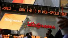 A news ticker in New York's Times Square on May 6, 2010. The Dow Jones industrials plunged nearly 1,000 points before ending the day down at 347. (Daniel Barry/Daniel Barry/Getty Images)