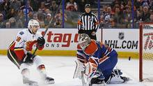Calgary Flames forward Matt Stajan scores a penalty shot goal against Edmonton Oilers goaltender Victor Fasth during the second period at Rexall Place. (Perry Nelson/USA Today Sports)