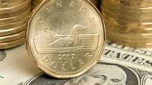 Although the Canadian dollar has been near parity with the greenback recently, there is often a big gap between prices. (ADRIAN WYLD/CP/ADRIAN WYLD/CP)