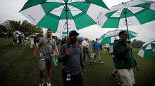 Patrons leave as play is suspended during the Par 3 Tournament at Augusta National Golf Club in Augusta, California, U.S., April 5, 2017. (LUCY NICHOLSON/REUTERS)