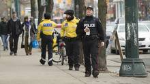Police are seen in Toronto on Jan. 31. (Kevin Van Paassen For The Globe and Mail)