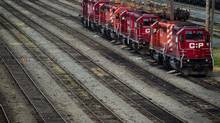 Canada's two main railways are expected to show continued profit strength in their quarterly earnings reports this week, despite recent signs of sagging grain and coal traffic and slightly lower container shipments. (DARRYL DYCK/THE CANADIAN PRESS)