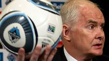 Vancouver Whitecaps' executive chair John Furlong holds up a soccer ball while speaking after the MLS soccer team named him to the position in Vancouver, B.C., on Thursday, April 12, 2012. Furlong, the former CEO of Vancouver Winter Olympic games organizing committee, will be the Whitecaps most senior executive. THE CANADIAN PRESS/Darryl Dyck (Darryl Dyck/CP)