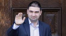 Dimitri Soudas, a spokesman in the office of Prime Minister Stephen Harper, waves as he leaves the Langevin Block in Ottawa in this June 15, 2010 file photo. (CHRIS WATTIE/REUTERS/Chris Wattie)