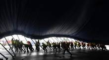 """Some 60 workers raise a section of the Cirque du Soleil """"Big Top"""" at Marymoor Park in Redmond, Wash. in 2013. (Greg Gilbert/(File) AP/The Seattle Times)"""